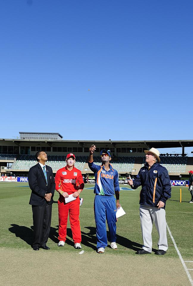 TOWNSVILLE, AUSTRALIA - AUGUST 14:  Unmukt Chand of India and Matthew Bentley of Zimbabwe toss the coin before the ICC U19 Cricket World Cup 2012 match between India and Zimbabwe at Tony Ireland Stadium on August 14, 2012 in Townsville, Australia.  (Photo by Ian Hitchcock-ICC/Getty Images)