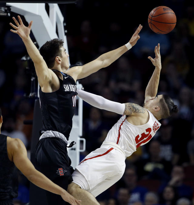 Houston guard Rob Gray shoots under pressure from San Diego State forward Max Montana (10) during the second half of an NCAA men's college basketball tournament first-round game Thursday, March 15, 2018, in Wichita, Kan. Houston won 67-65. (AP Photo/Charlie Riedel)