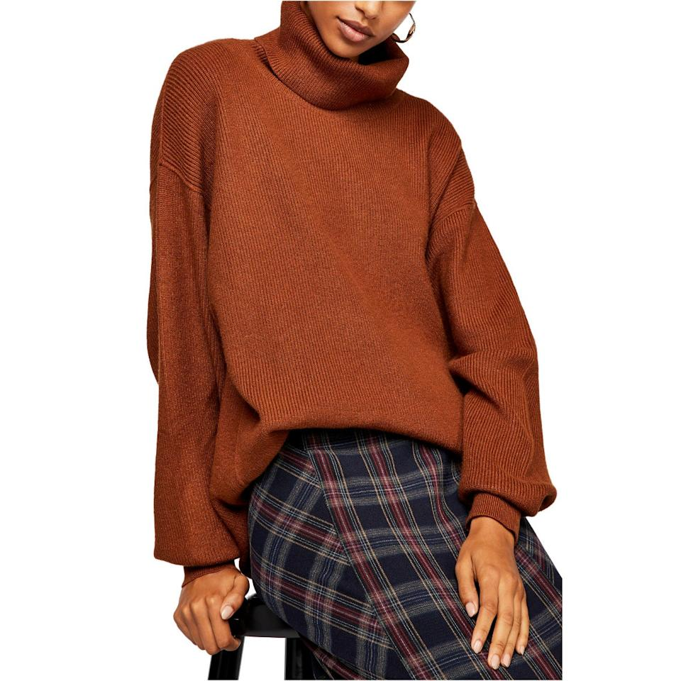 "This slouchy-but-polished Free People turtleneck (specifically in this lush terracotta color) is the perfect piece to wear <a href=""https://www.glamour.com/story/how-to-wear-sweater-over-dress?mbid=synd_yahoo_rss"" target=""_blank"">tucked into a skirt</a> or thrown over a pair of lived-in jeans. $149, Nordstrom. <a href=""https://shop.nordstrom.com/s/free-people-knit-tunic/5505985/full?origin=category-personalizedsort&breadcrumb=Home%2FSale%2FCyber%20Monday&color=terracotta"">Get it now!</a>"