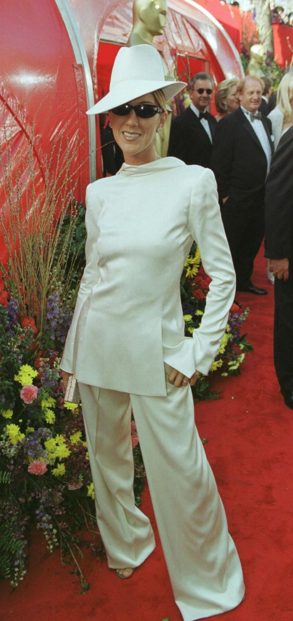 <p>Dion opted to wear a suit jacket backwards in 1999. Enough said. <em>[Photo: PA]</em> </p>