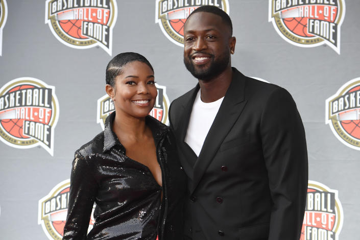 Gabrielle Union and Dwyane Wade pose for a photo on the red carpet for the 2021 Basketball Hall of Fame Enshrinement ceremony, Saturday, Sept. 11, 2021, in Springfield, Mass. (AP Photo/Jessica Hill)