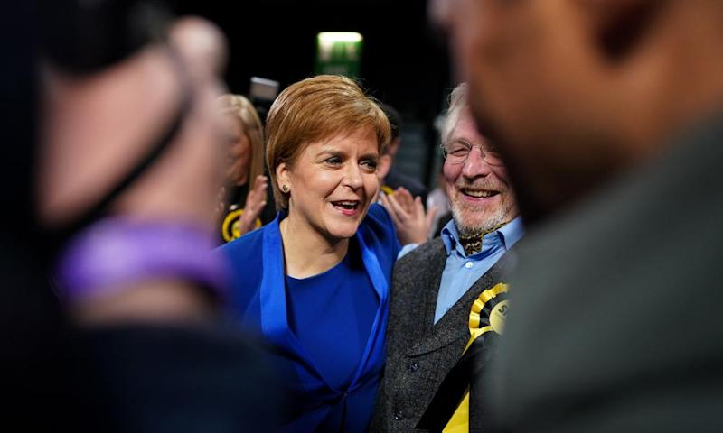 Nicola Sturgeon is mobbed by SNP supporters as she arrives at the counting hall.