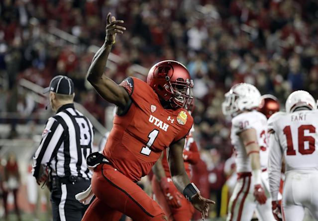 "Utah quarterback <a class=""link rapid-noclick-resp"" href=""/ncaaf/players/264309/"" data-ylk=""slk:Tyler Huntley"">Tyler Huntley</a> (1) was named the team's starter on Monday. (AP)"