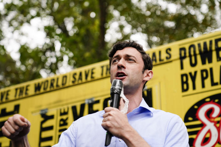 "Democratic candidate for Senate Jon Ossoff speaks to a crowd during a ""Get Out the Early Vote"" event at the SluttyVegan ATL restaurant on Tuesday, Oct. 27, 2020, in Jonesboro, Ga. (AP Photo/Brynn Anderson)"