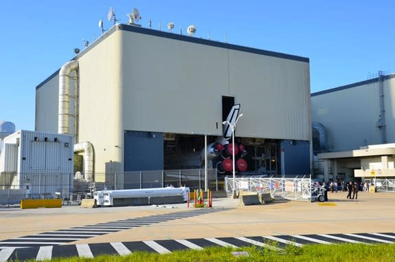 Space shuttle Atlantis backs out of Orbiter Processing Facility-1 (OPF-1) at NASA's Kennedy Space Center in Florida in 2011. The building will now be used by Boeing to service the U.S. Air Force's X-37B space plane.