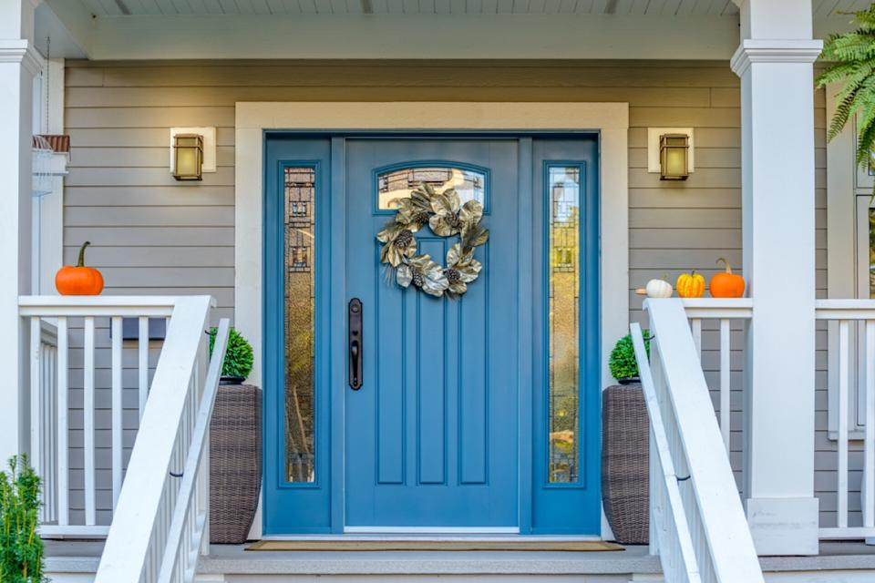 blue front entry door with wreath