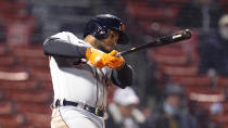 Detroit Tigers' Jeimer Candelario follows through on his three-run home run during the 10th inning of the team's baseball game against the Boston Red Sox at Fenway Park, Wednesday, May 5, 2021, in Boston. (AP Photo/Charles Krupa)