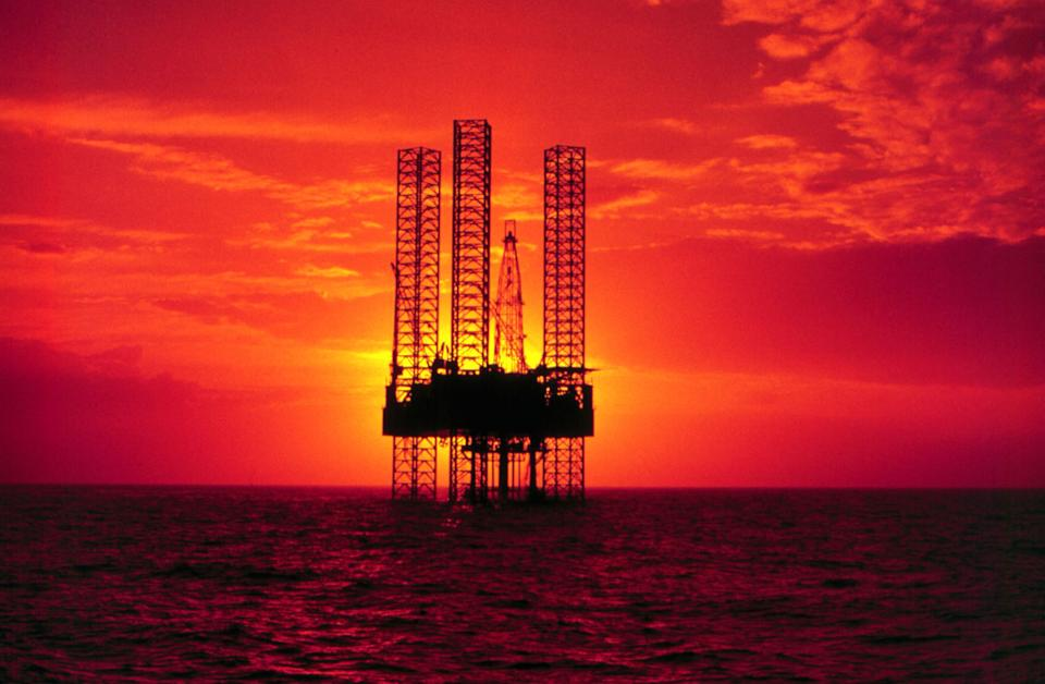 378913 01: Pennzenergy Company Oil Exploration Drilling Rig In The Gulf Of Mexico During Sunset.  (Photo By Getty Images)