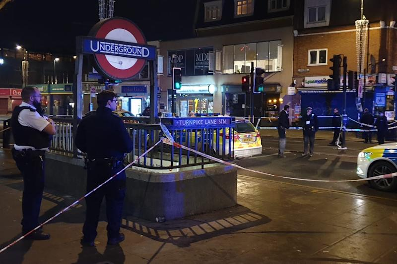 Attack: police at the scene of the shooting near Turnpike Lane station: London999