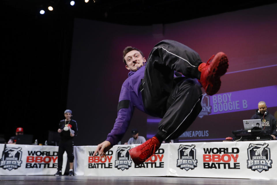 """Jacob """"Boogie B"""" Riley, of Minneapolis, competes during the World Bboy Battle Saturday, Dec. 21, 2019, in New York. Many in the breaking community are eager for the art form to expand its audience after the International Olympic Committee announced that it would become an official sport at the Paris 2024 games. But that optimism is hardly unanimous. (AP Photo/Frank Franklin II)"""