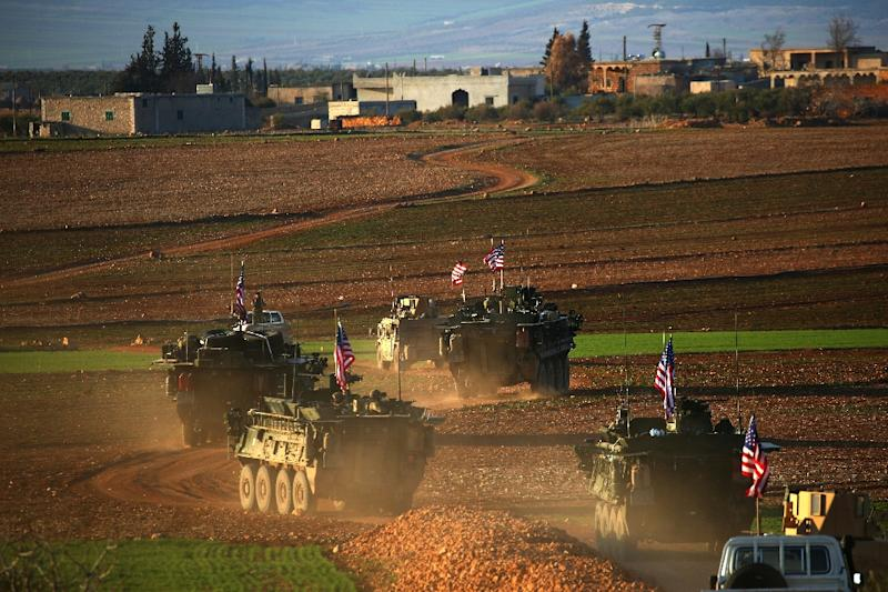 A convoy of US forces armoured vehicles drives near the village of Yalanli, on the western outskirts of the northern Syrian city of Manbij, on March 5, 2017 (AFP Photo/DELIL SOULEIMAN)