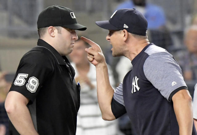 New York Yankees manager Aaron Boone, right, confronts umpire Nic Lentz (59) before being tossed from a baseball game against the Detroit Tigers during the fifth inning Friday, Aug. 31, 2018, at Yankee Stadium in New York. (AP Photo/Bill Kostroun)