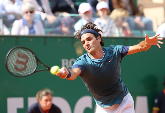 Roger Federer of Switzerland returns the ball to Novak Djokovic of Serbia, during their semifinal match of the Monte Carlo Tennis Masters tournament in Monaco, Saturday, April, 19, 2014. Federer won 7-6, 6-2. (AP Photo/Claude Paris)