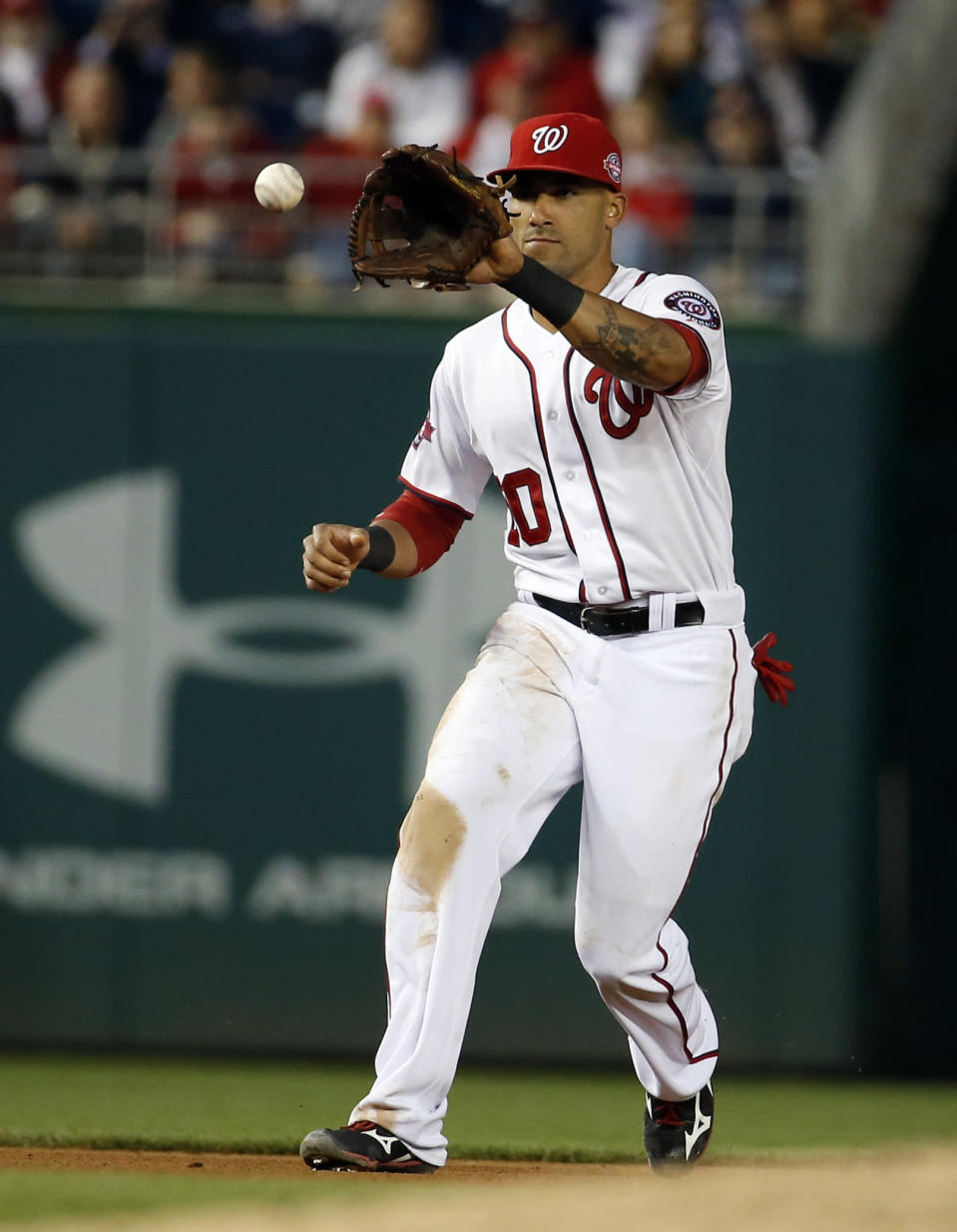 Washington Nationals shortstop Ian Desmond fields a ball hit by Toronto Blue Jays' Chris Colabello during the fifth inning of a baseball game at Nationals Park, Wednesday, June 3, 2015, in Washington. Colabello was out at first. (AP Photo/Alex Brandon)