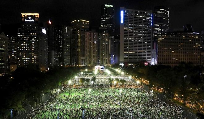 While banned by police, more than 1,000 Hongkongers turned up in Victoria Park for the annual Tiananmen Square candlelight vigil on June 4. Photo: May Tse