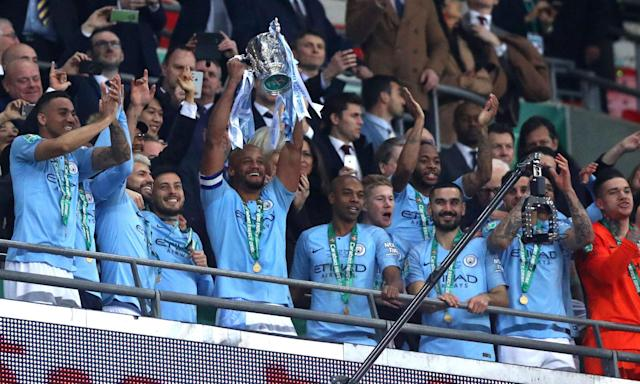 Manchester City players celebrate with the EFL Cup trophy on Sunday at Wembley. (Getty)