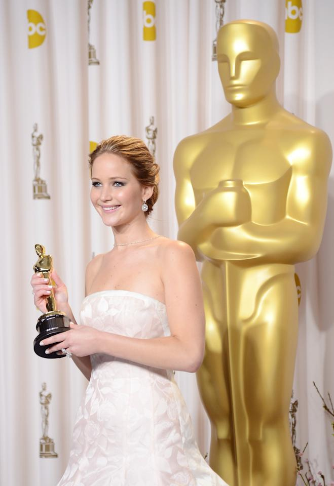 "HOLLYWOOD, CA - FEBRUARY 24:  Actress Jennifer Lawrence, winner of the Best Actress award for ""Silver Linings Playbook,"" poses in the press room during the Oscars held at Loews Hollywood Hotel on February 24, 2013 in Hollywood, California.  (Photo by Jason Merritt/Getty Images)"