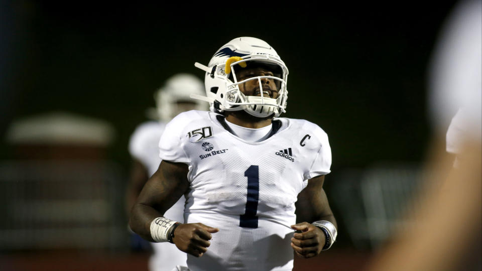 Georgia Southern quarterback Shai Werts (1) celebrates his touchdown during the second half of an NCAA college football game against Appalachian State Thursday, Oct. 31, 2019, in Boone, NC. (AP Photo/Brian Blanco)