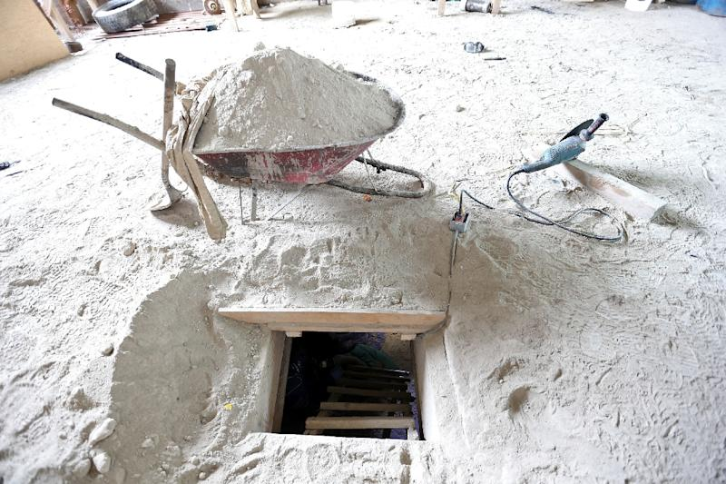 """The alleged end of the tunnel through which Mexican drug lord Joaquin """"El Chapo"""" Guzman could have escaped from prison, at a house in Almoloya de Juarez, Mexico, on July 12, 2015 (AFP Photo/)"""