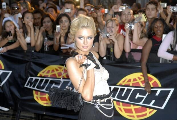 Paris Hilton arrives on the red carpet at the MuchMusic Video Awards in Toronto, June 18, 2006. On Thursday, Bell Media announced the network is relaunching on TikTok. (Aaron Harris/The Canadian Press - image credit)