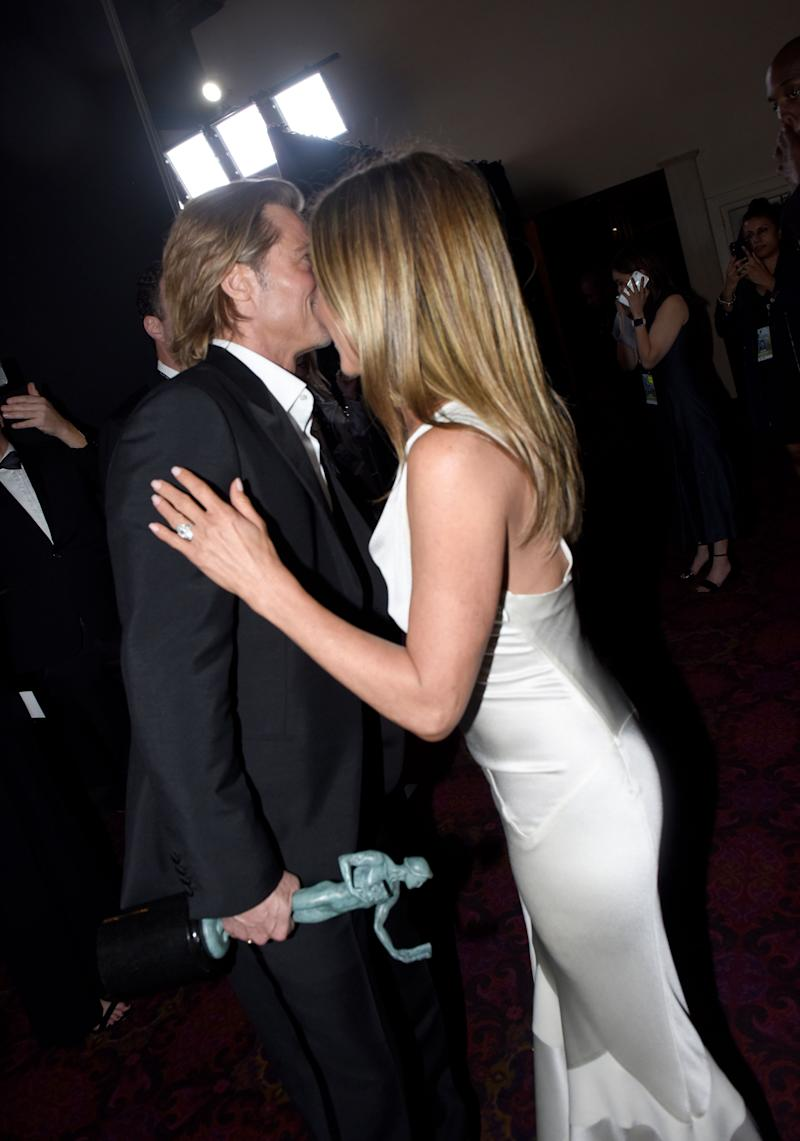 "As the body language experts will breathlessly tell you, their posture shows <a href=""https://pagesix.com/2020/01/21/jennifer-aniston-and-brad-pitts-love-never-died-says-body-language-expert/"" target=""_blank"" rel=""noopener noreferrer"">their love &ldquo;never died&rdquo;</a>! (Photo: Vivien Killilea via Getty Images)"