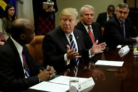 U.S. President Donald Trump talks with Kenneth Frazier (L) CEO of Merck as Robert Hugin (2nd R) Executive Chairman of Celgene and Robert Bradway (R) CEO of Amgen look on during a meeting with Pharma industry representatives at the White House in Washington, U.S., January 31, 2017. REUTERS/Yuri Gripas