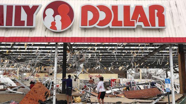 PHOTO: People look on at a damaged store after Hurricane Michael passed through on Oct. 10, 2018, in Panama City, Fla. (Mark Wallheiser/Getty Image)