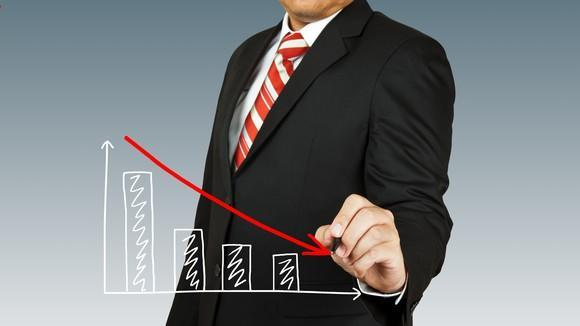 Person drawing a downward sloping chart.