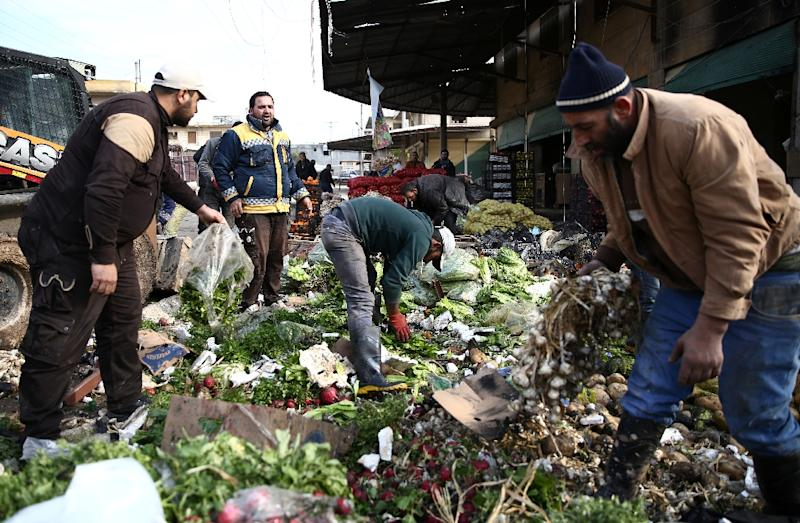 Vegetables litter the ground after a car bomb exploded in a market in the northern Syrian city of Afrin on December 16, 2018 (AFP Photo/Nazeer AL-KHATIB)