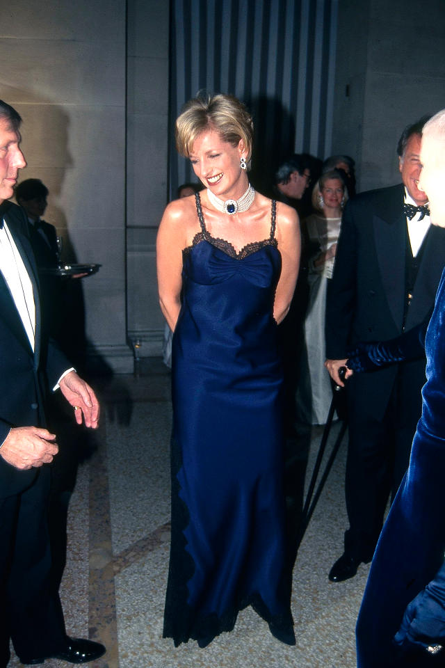 <p>Way before they were ubiquitous, Diana rocked up to the 1995 Met Gala in a lace-trimmed, navy slip dress, wowing guests and fashion critics alike. <em>[Photo: Getty]</em> </p>