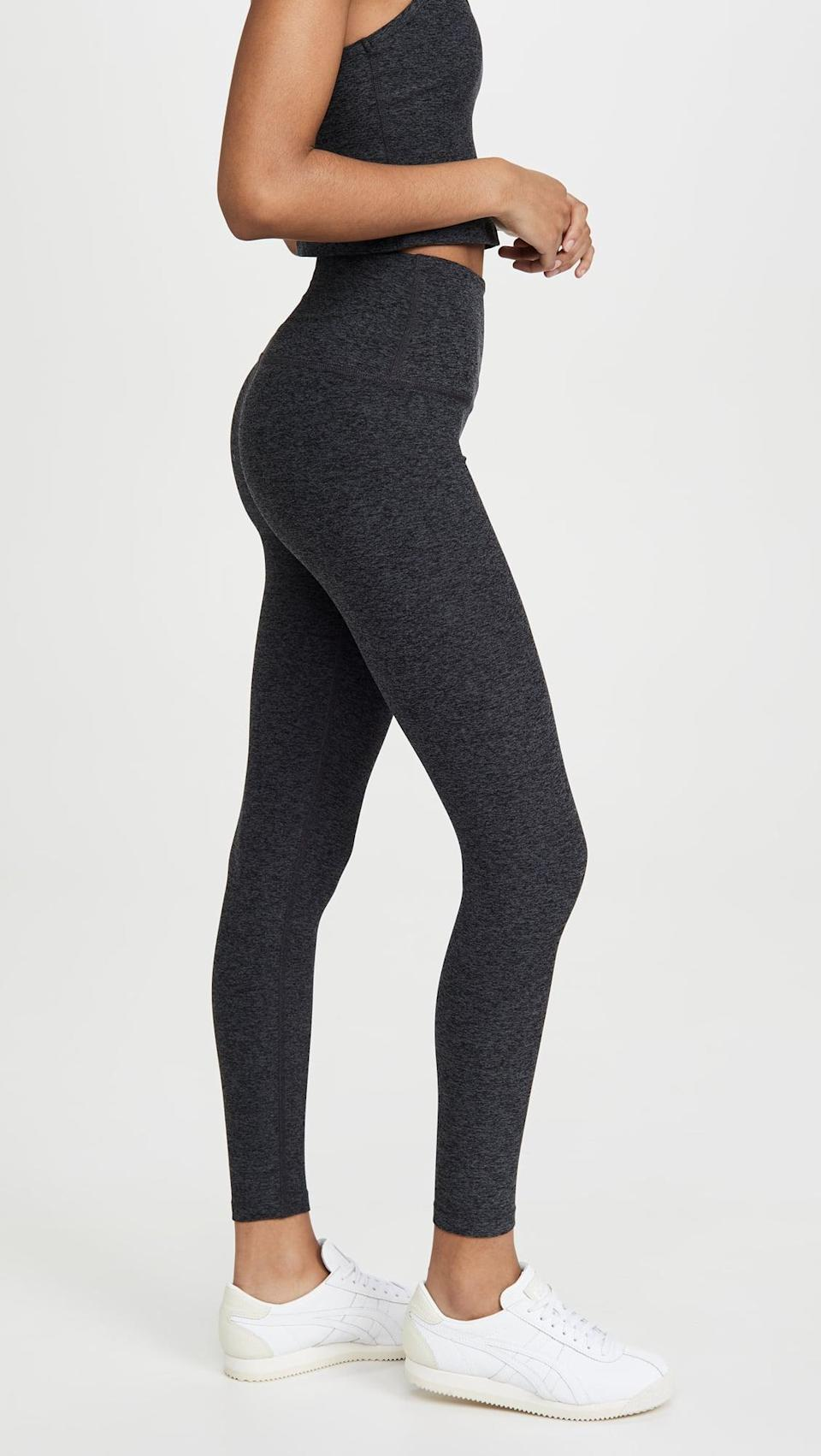 """<p>""""I have been living in these <span>Beyond Yoga High Waisted Midi Leggings</span> ($97). The fabric is like butter, and it's a little bit thicker, making chilly days at home that much more inviting. Plus, I'm infinitely more likely to get a yoga session in after work."""" - IY</p>"""