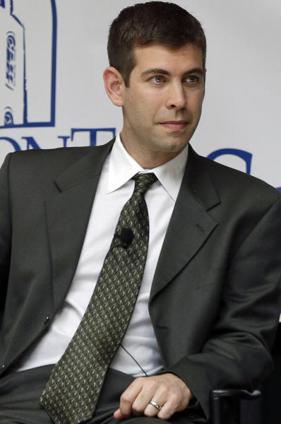 FILE - In this April 10, 2013, file photo, Butler men's basketball coach Brad Stevens takes part in a panel on integrity in college basketball, in Nashville, Tenn. The Boston Celtics announced Wednesday, July 3, 2013, that Stevens was hired as the team's head coach, replacing Doc Rivers, who was traded to the Los Angeles Clippers. (AP Photo/Mark Humphrey, File)