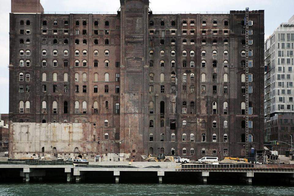 <p>An old Domino Sugar factory sits on the edge of the bustling and trendy Williamsburg neighborhood in Brooklyn. </p>