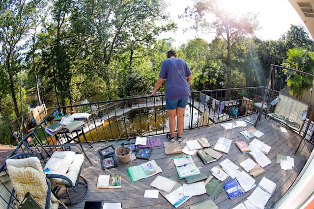 <p>Stacey House looking off her balcony as her important papers and books are set to dry outside ruined by water after Hurricane Harvey, Thursday, August 31, 2017 in Baytown, TX. (Photo: Juan DeLeon/Icon Sportswire via Getty Images) </p>