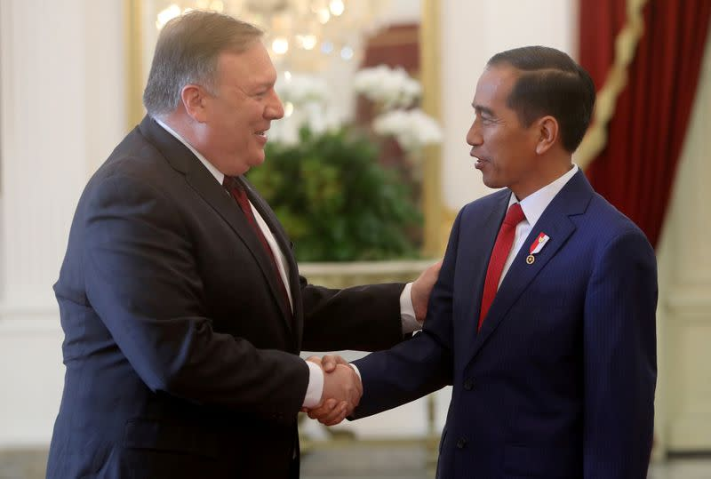 FILE PHOTO: Indonesia's President Widodo shakes hand with U.S. Secretary of State Pompeo before their meeting in Jakarta