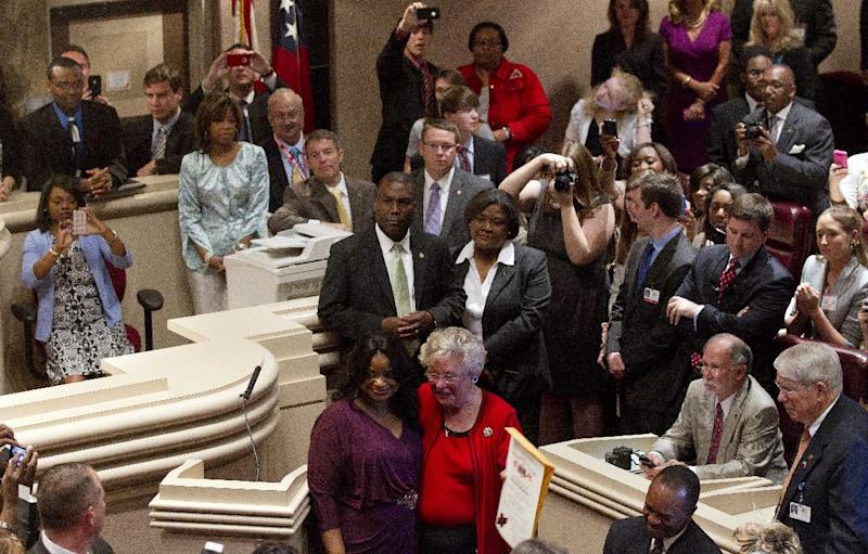 Oscar-winning actress Octavia Spencer, front left, poses with Alabama Lt. Gov. Kay Ivey during a combined session of the legislature at the Alabama Statehouse in Montgomery, Ala., Wednesday, March 21, 2012. Spencer was greeted by more than 400 people as she arrived at the Alabama Statehouse to a hero's welcome. Earlier this year, Spencer won a best supporting actress Oscar for her performance in The Help. (AP Photo/Dave Martin)
