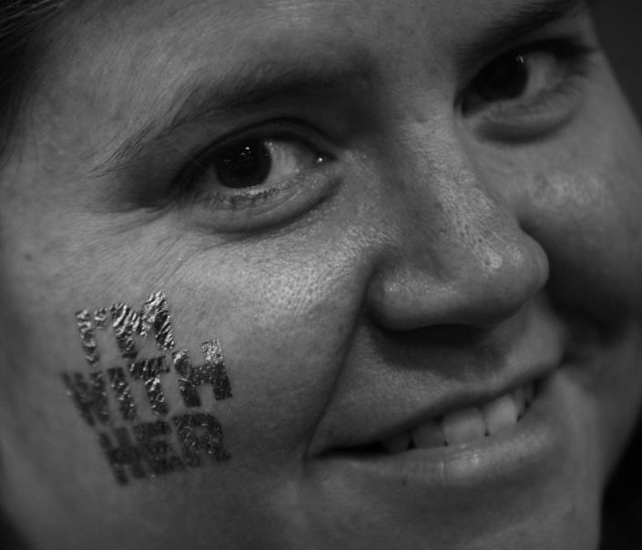 <p>A delegate shows off her temporary tattoo at the DNC in Philadelphia, PA. on July 28, 2016. (Photo: Khue Bui for Yahoo News) </p>