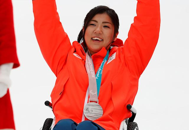 Alpine Skiing - Pyeongchang 2018 Winter Paralympics - Women's Slalom - Sitting - Jeongseon Alpine Centre - Jeongseon, South Korea - March 18, 2018 - Momoka Muraoka of Japan celebrates with her silver medal. REUTERS/Paul Hanna