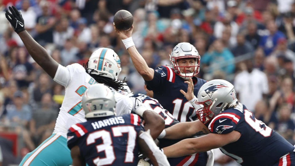 New England Patriots quarterback Mac Jones (10) passes under pressure during the first half of an NFL football game against the Miami Dolphins, Sunday, Sept. 12, 2021, in Foxborough, Mass. (AP Photo/Winslow Townson)