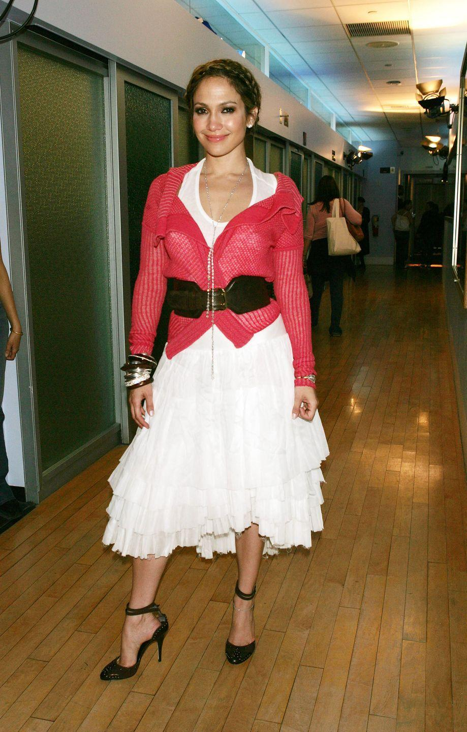 <p>Extremely wide belts were another early 2000s fashion trend that probably won't return. They were typically worn either right in the middle of your waist, over a dress or a shirt (like Jennifer Lopez did here), or they were put over belt loops on low-rise jeans. </p>