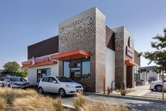 A Dunkin' Donuts store with a drive-thru lane
