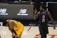 Los Angeles Clippers guard Patrick Beverley, right, gestures after a foul that was committed by the Utah Jazz as the Jazz's guard Donovan Mitchell looks down during the second half in Game 4 of a second-round NBA basketball playoff series Monday, June 14, 2021, in Los Angeles. (AP Photo/Mark J. Terrill)
