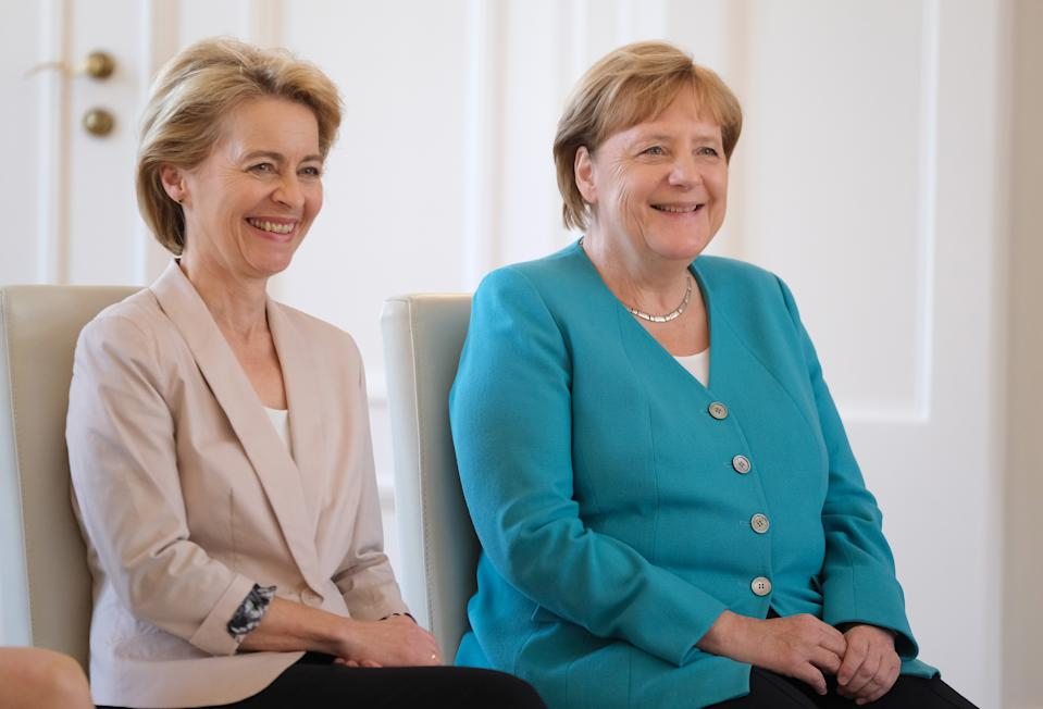 BERLIN, GERMANY - JULY 17: German Chancellor Angela Merkel (R) and outgoing Defense Minister Ursula von der Leyen attend the appointment ceremony of new Defense Minister Annegret Kramp-Karrenbauer at Schloss Bellevue on July 17, 2019 in Berlin, Germany. Von der Leyen is relinquishing her post following her election yesterday by the European Parliament by a slim margin as new president of the European Commission. (Photo by Sean Gallup/Getty Images)