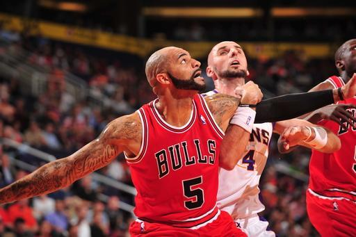 PHOENIX, AZ - NOVEMBER 14: Carlos Boozer #5 of the Chicago Bulls battles for position with Marcin Gortat #4 of the Phoenix Suns on November 14, 2012 at U.S. Airways Center in Phoenix, Arizona. (Photo by Barry Gossage/NBAE via Getty Images)