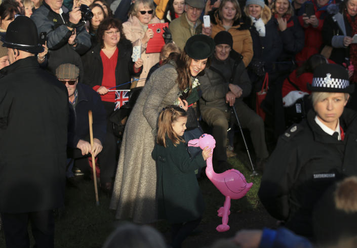 Britain's Catherine, Duchess of Cambridge, center left, speaks with her daughter Princess Charlotte as she holds a pink flamingo while greeting the public outside the St Mary Magdalene Church in Sandringham in Norfolk, England, Wednesday, Dec. 25, 2019. | Jon Super—AP