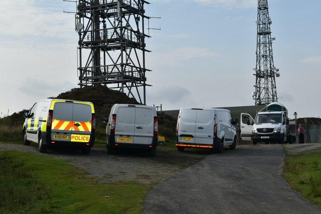 Police vehicles at the scene near the summit of Brown Clee Hill in Shropshire