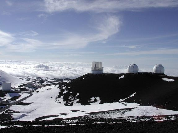 The Subaru Telescope on Mauna Kea in Hawaii. This high peak remains cold, even snowy, even when the beaches below are balmy.