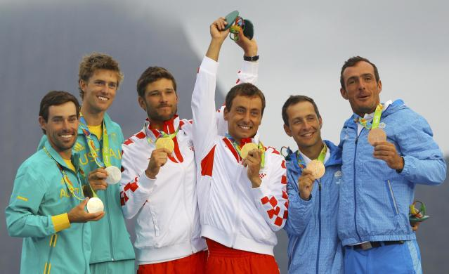 2016 Rio Olympics - Sailing - Victory Ceremony - Men's Two Person Dinghy - 470 - Victory Ceremony - Marina de Gloria - Rio de Janeiro, Brazil - 18/08/2016. Gold medalists Sime Fantela (CRO) of Croatia and Igor Marenic (CRO) of Croatia, Silver medalists Mathew Belcher (AUS) of Australia and William Ryan (AUS) of Australia and Bronze medalists Panagiotis Mantis (GRE) of Greece and Pavlos Kagialis (GRE) of Greece pose with their medals. REUTERS/Brian Snyder FOR EDITORIAL USE ONLY. NOT FOR SALE FOR MARKETING OR ADVERTISING CAMPAIGNS.