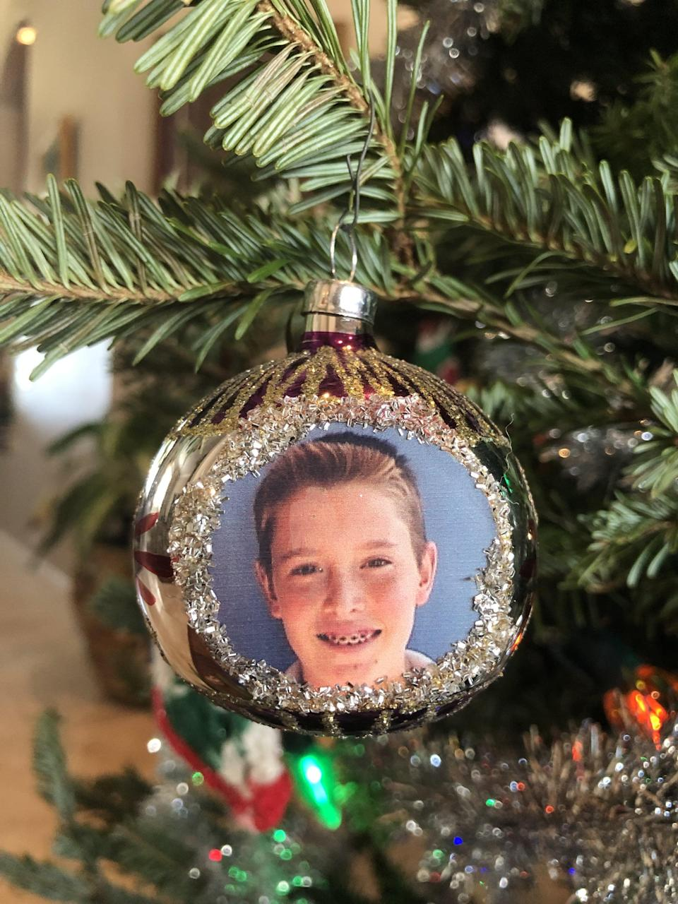 <p>I can smell the hair gel just looking at this ornament.</p>