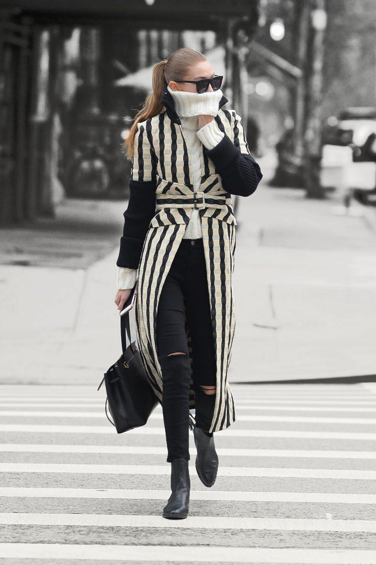 Is Gigi Hadid just really cold? (Photo by Raymond Hall/GC Images)